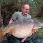 Carpe miroir 34 Kgs – Lac de curtons (Rainbow Lake) – Lac privé – Guido Glees