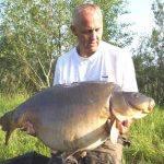 Carpe miroir 32,800 Kgs – Etang de la Croix Blanche – Lac privé – Peter Johnson